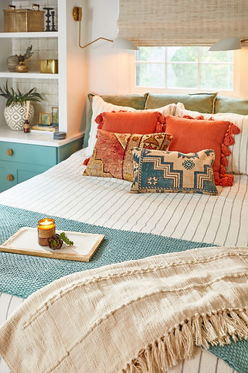 As one of our Accents of Kindness room makeovers, this master bedroom was designed to be peaceful and calming, but visually interesting with modern elements and pops of color.