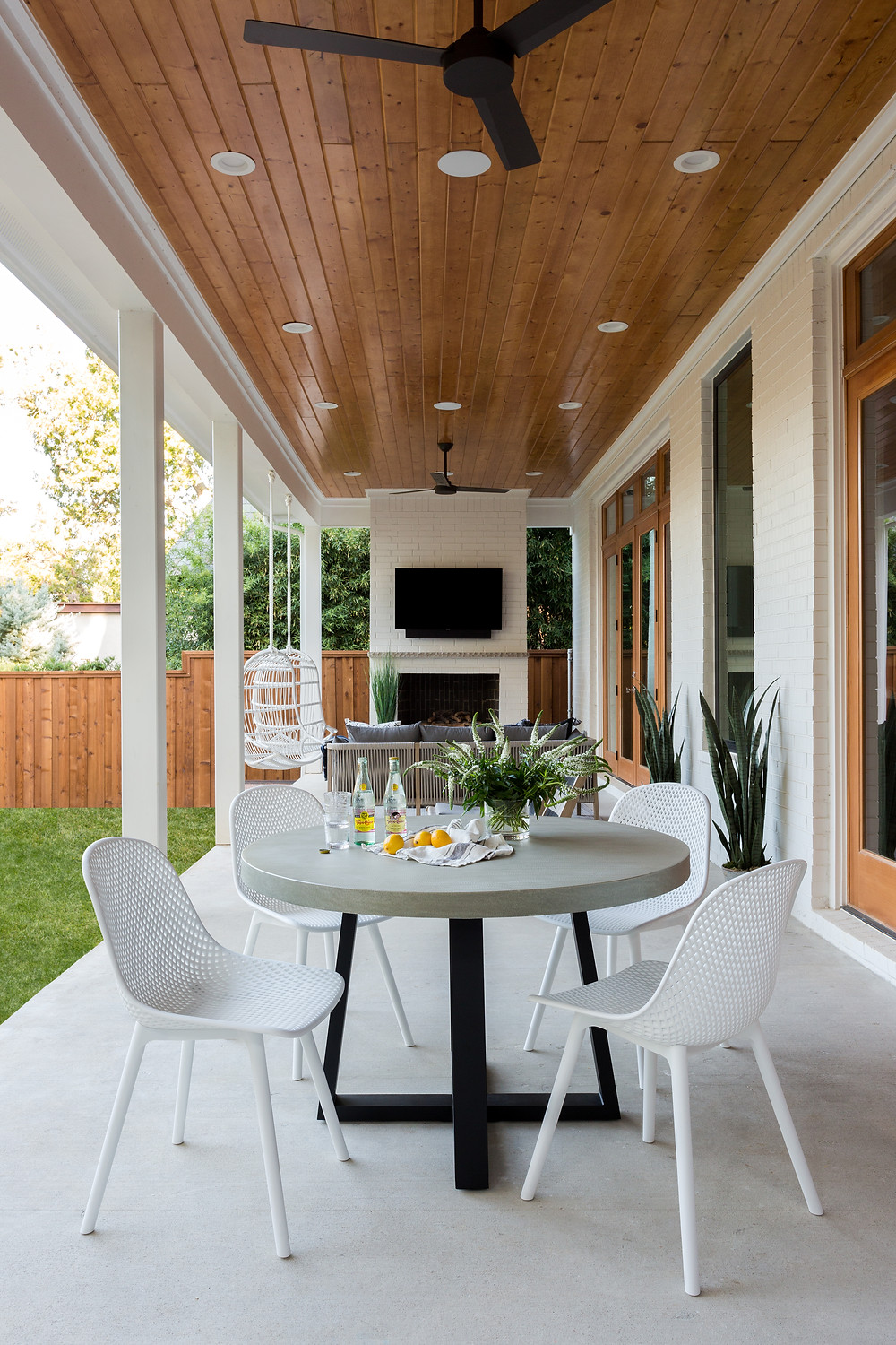 covered porch with wood ceiling and fireplace