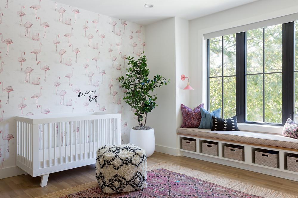 nursery with flamingo wallpaper