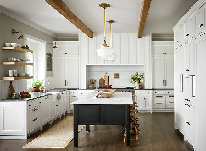 When clients hired reDesign home their scope of the project was to create a space that could allow the family to gather during meal prepping, entertaining and create wonderful memories. Their main concern was the scale of the original kitchen. Upper cabinetry and appliances were not proportionally sized compare to the large kitchen space, the island featured an odd shape and did not allow for enough sittings, the pantry door located in the butler pantry was limiting for an easy traffic flow and use of the space; also the window by sink area was lacking interest. We reconfigured the pantry door by having direct access from the kitchen and dedicated a separate bar area in the butler pantry. Also introduced a focal point with a large built-in hood over cook station to create a balance with the family room fireplace located opposite to the kitchen. The island became not only larger to allow enough sitting but a unique element in the space due to the introduction of unique finishes and design, also the window was highlighted with the introduction of mill work that connected design elements throughout the kitchen/bar.