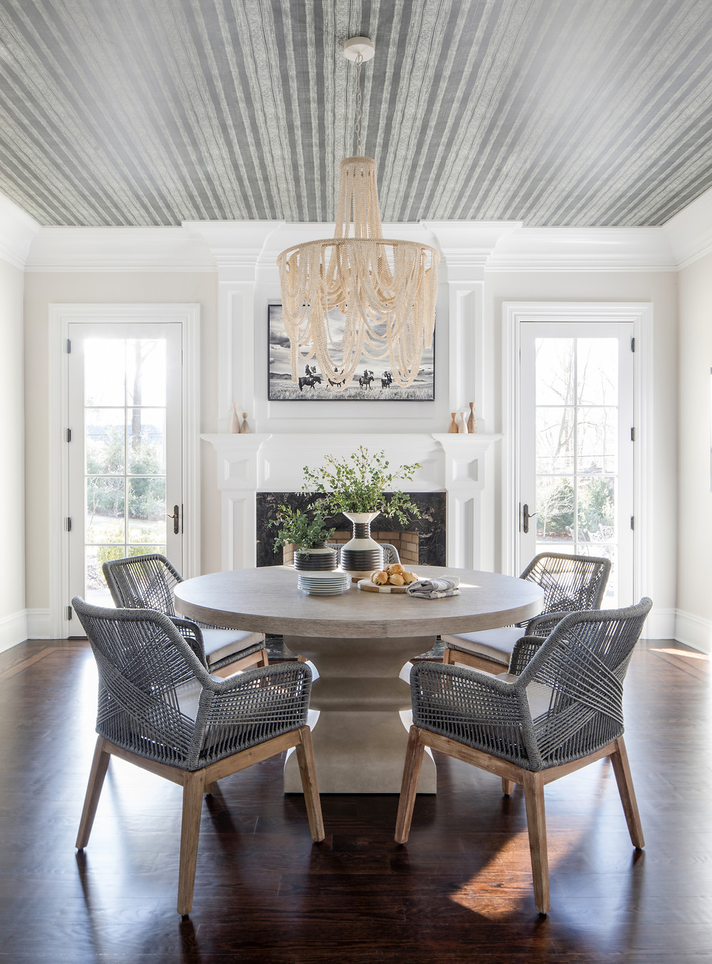 dining space with stripe wallpaper on ceiling
