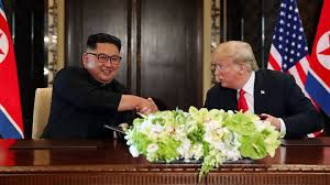 CAPTION: Trump and Kim have something to celebrate