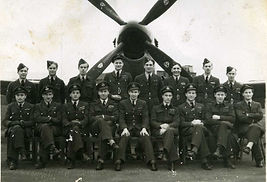 Blackie Blackwell (back left) in front of a Spitfire