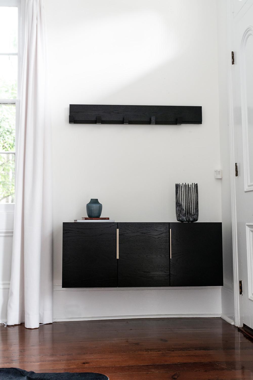 Ebony credenza installed on interior wall