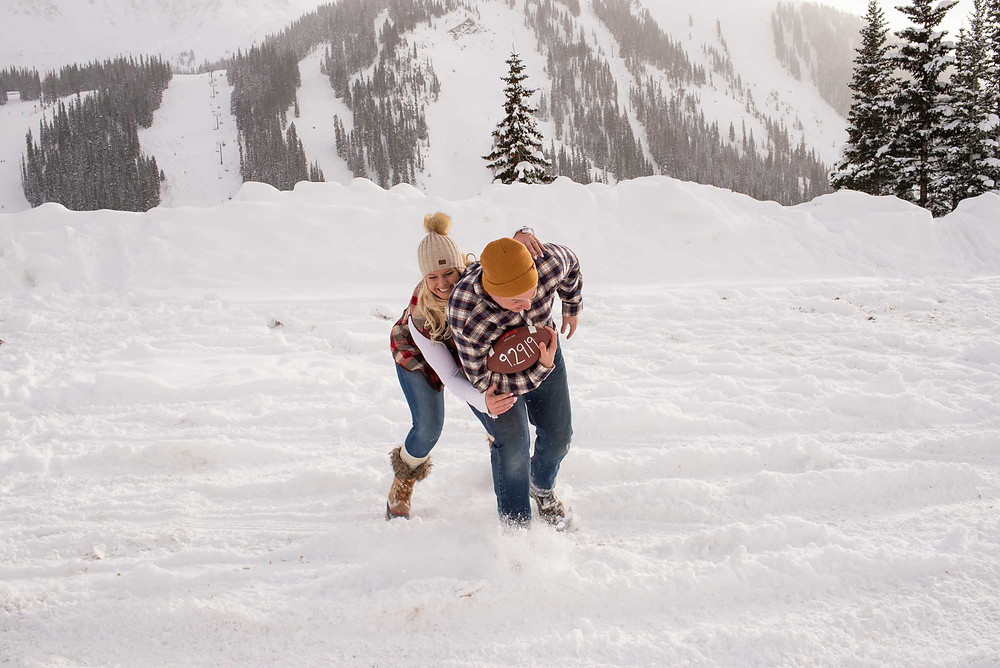 Snowy Football Themed Engagement Pictures