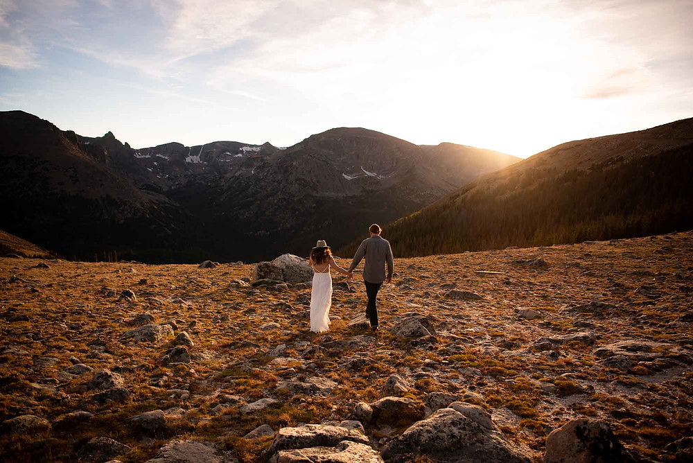 Engaged Couple Walking in Rocky Mountain National Park