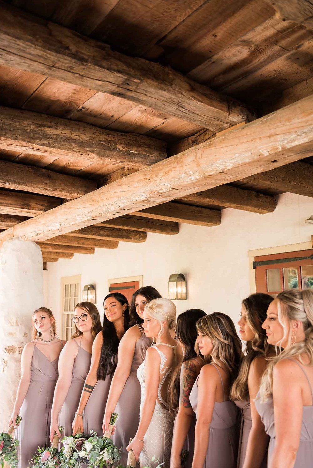 Bride and Bridesmaids Beneath Barn at Brandywine Manor House
