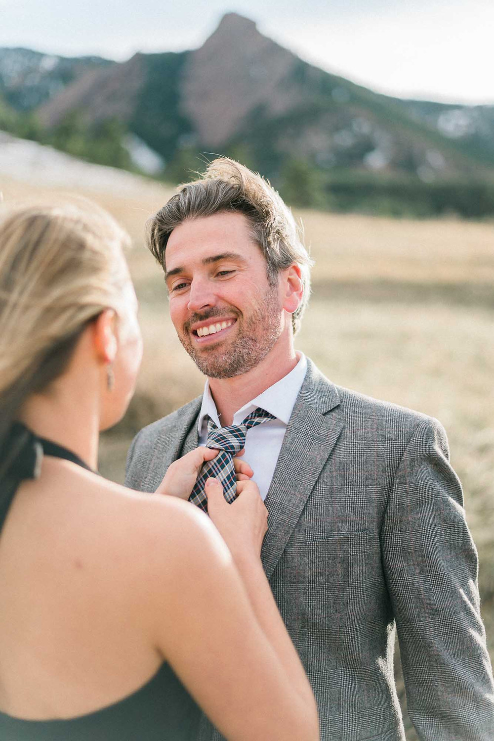 Fixing Husbands Tie at Portrait Session