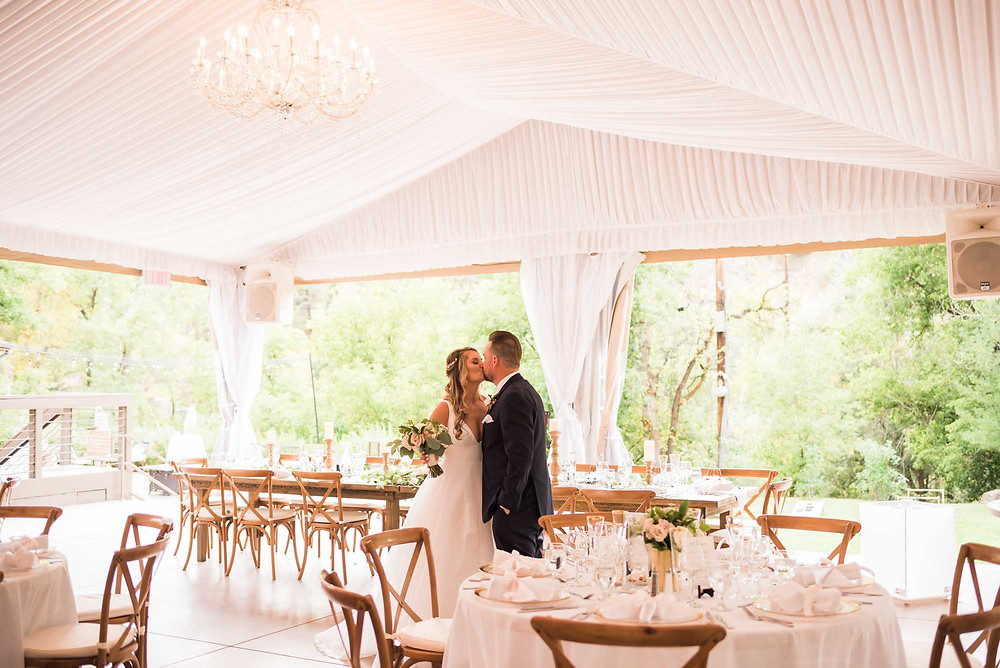 Bride and Groom in White Reception Tent at Wedgewood Boulder Creek
