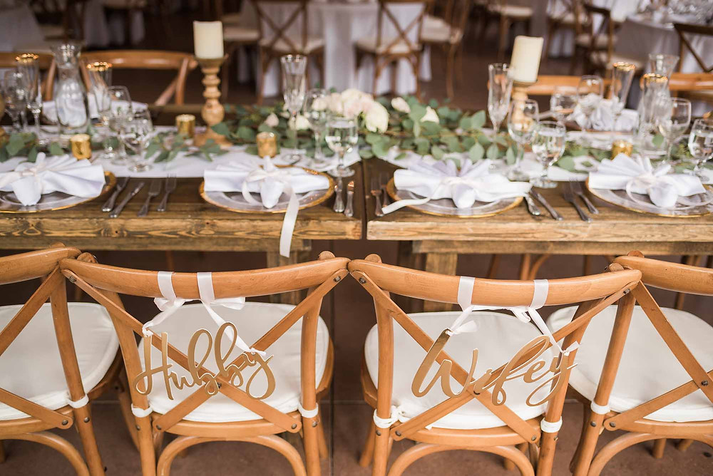 Hubby and Wifey Signs on Wooden Chairs at Reception