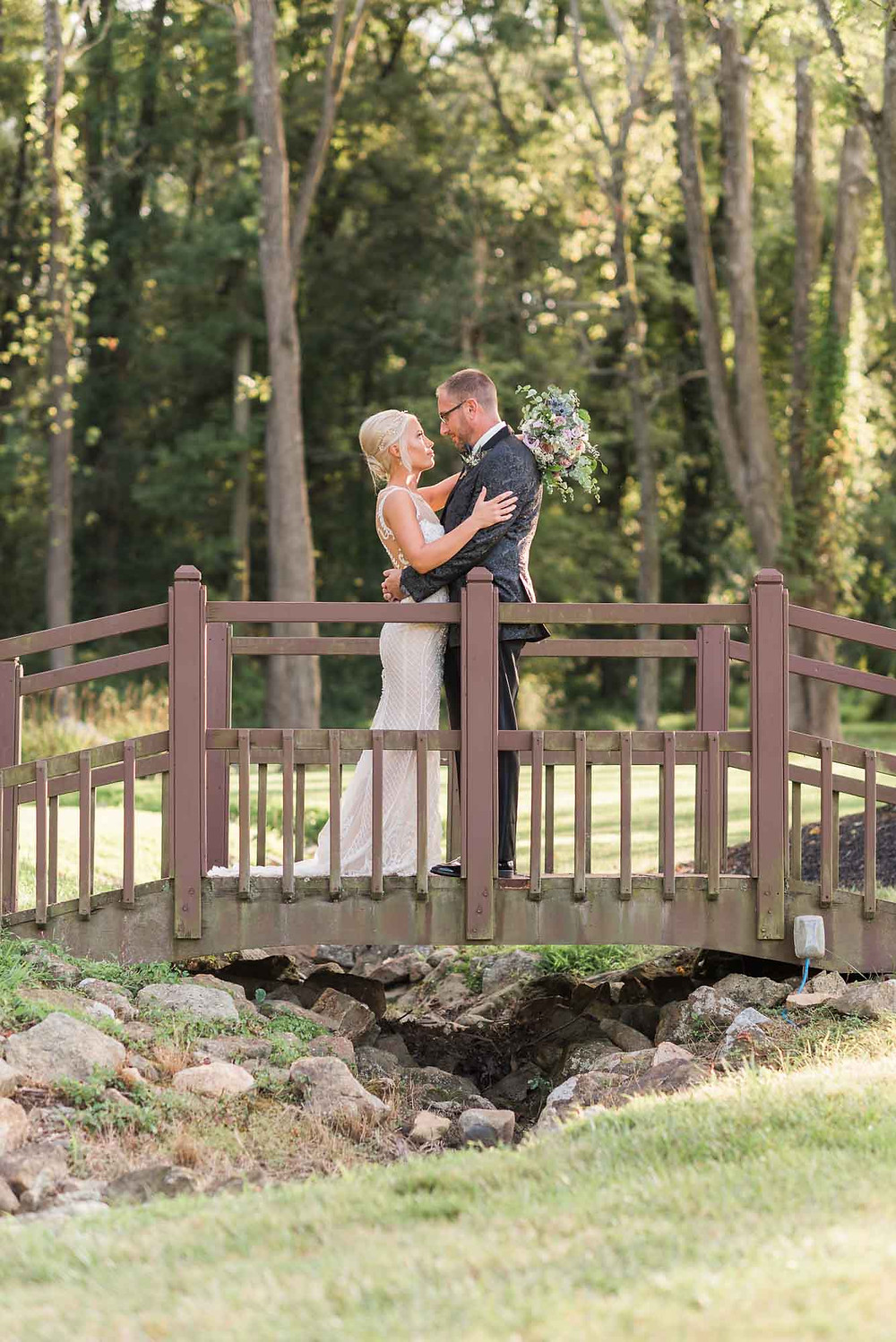 Bride and Groom on Bridge at Brandywine Manor House