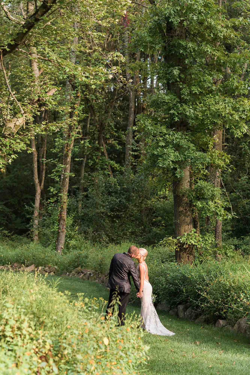 Bride and Groom in Field at Brandywine Manor House