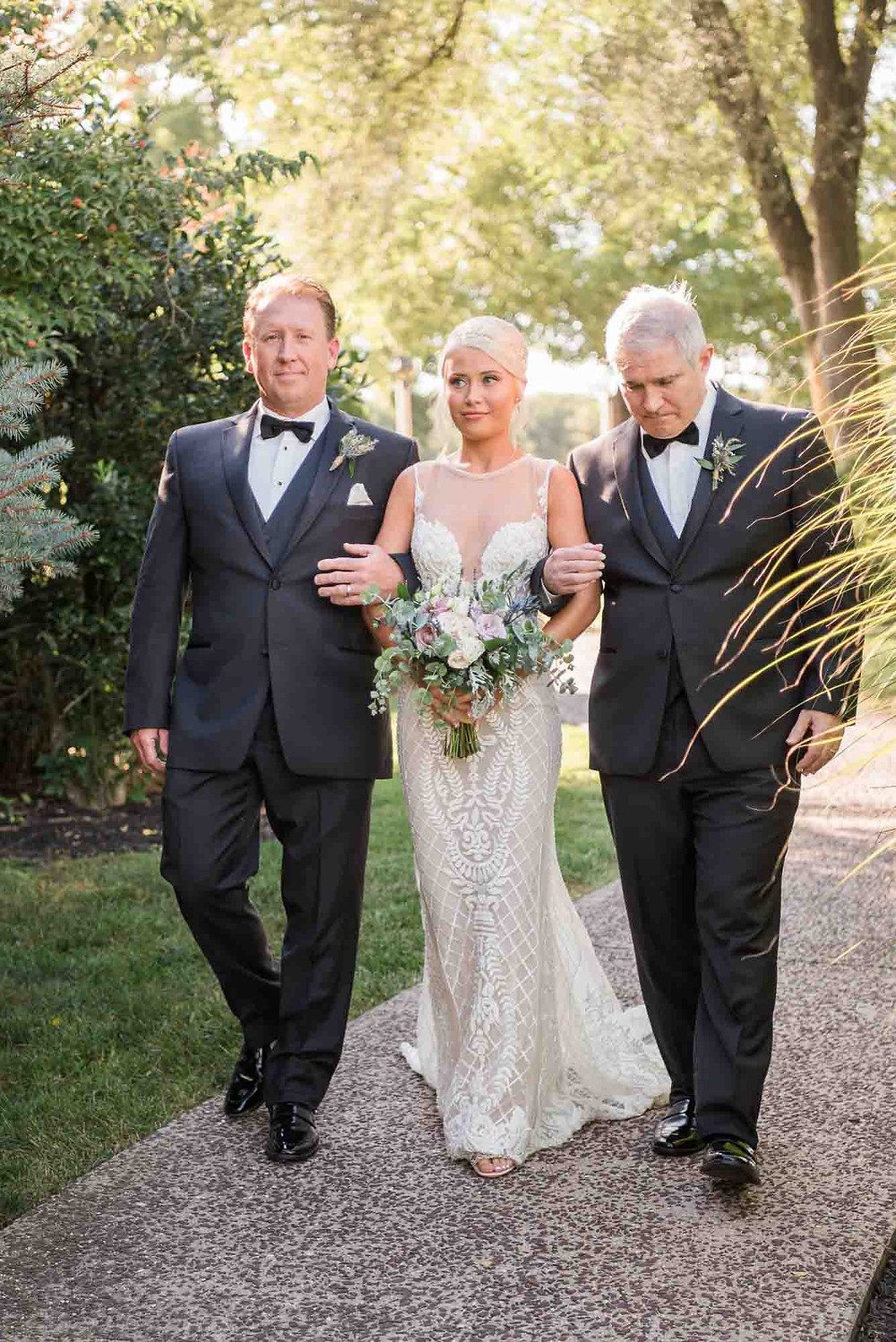 Bride Walking Down Aisle with Two Fathers