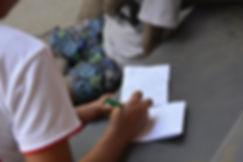 Myanmar orphan writing letter