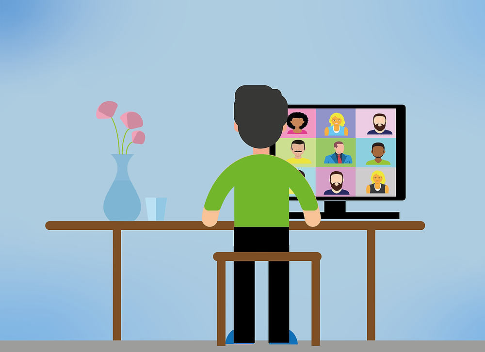 Animated person sitting at desk on a conference call.