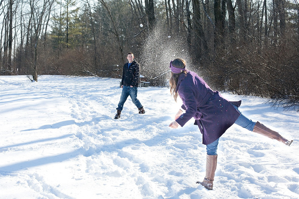 A person throwing a snowball at someone else.
