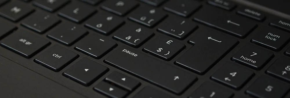 A keyboard with a pause button on it.