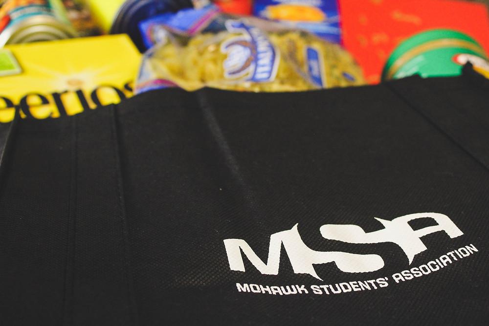 Non-perishable food items in a MSA branded bag.