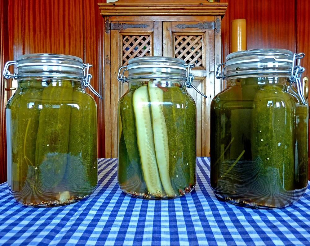 Jars with pickles in them.