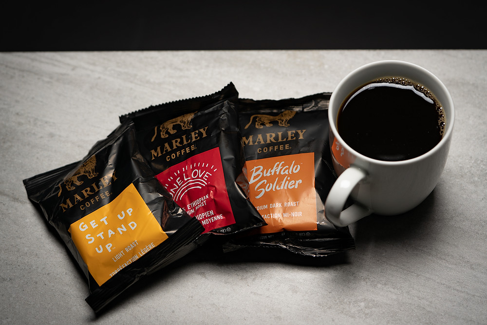 A cup of coffee and coffee bags.