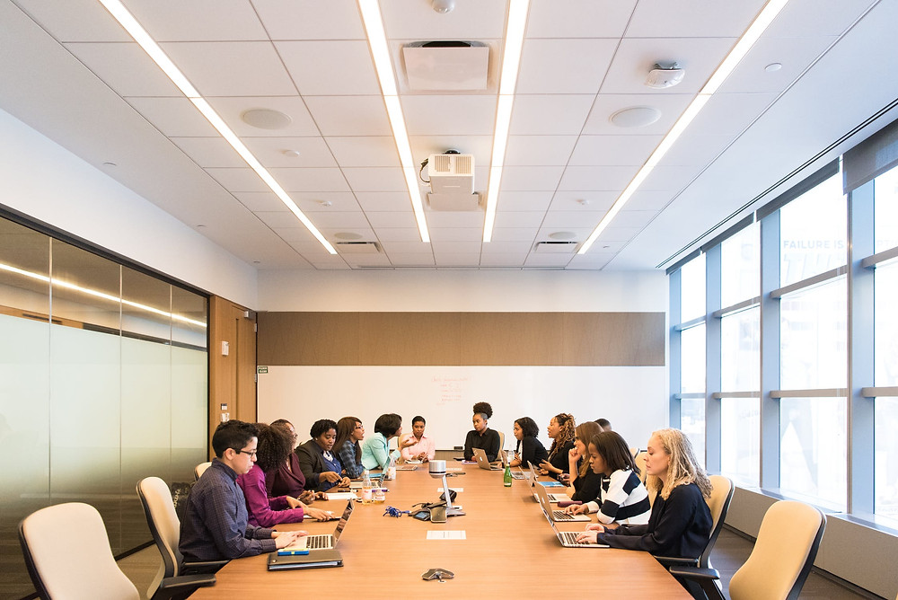 A group of people at a meeting.