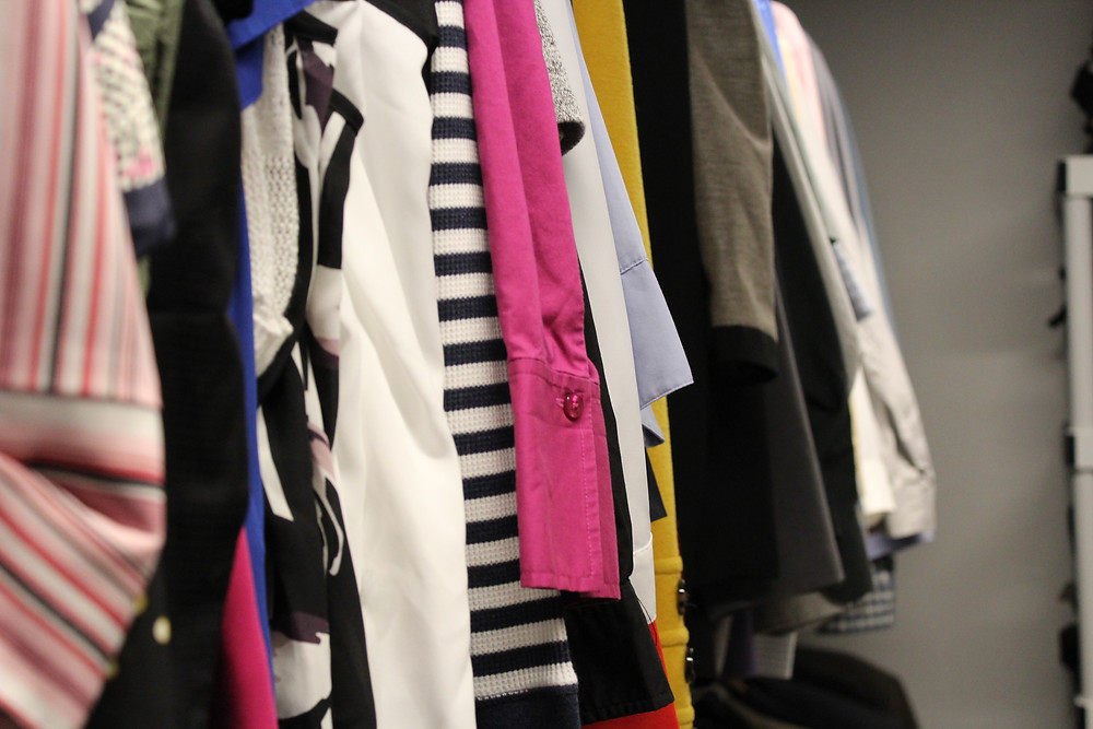 A selection of clothing on a hanger.