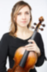 Luba Tunnicliffe is a freelance viola player from England, who plays in the Pelleas Ensemble and the Ruisi Quartet.