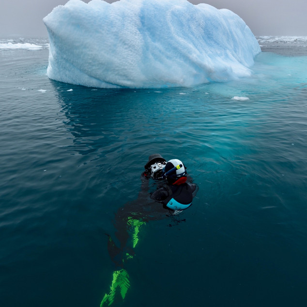 Photographing icebergs in the chilly Antarctic waters.