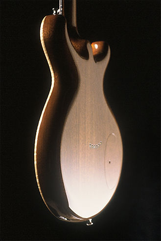Concave-guitar-back-Thierry-Andre-Instruments-Orange