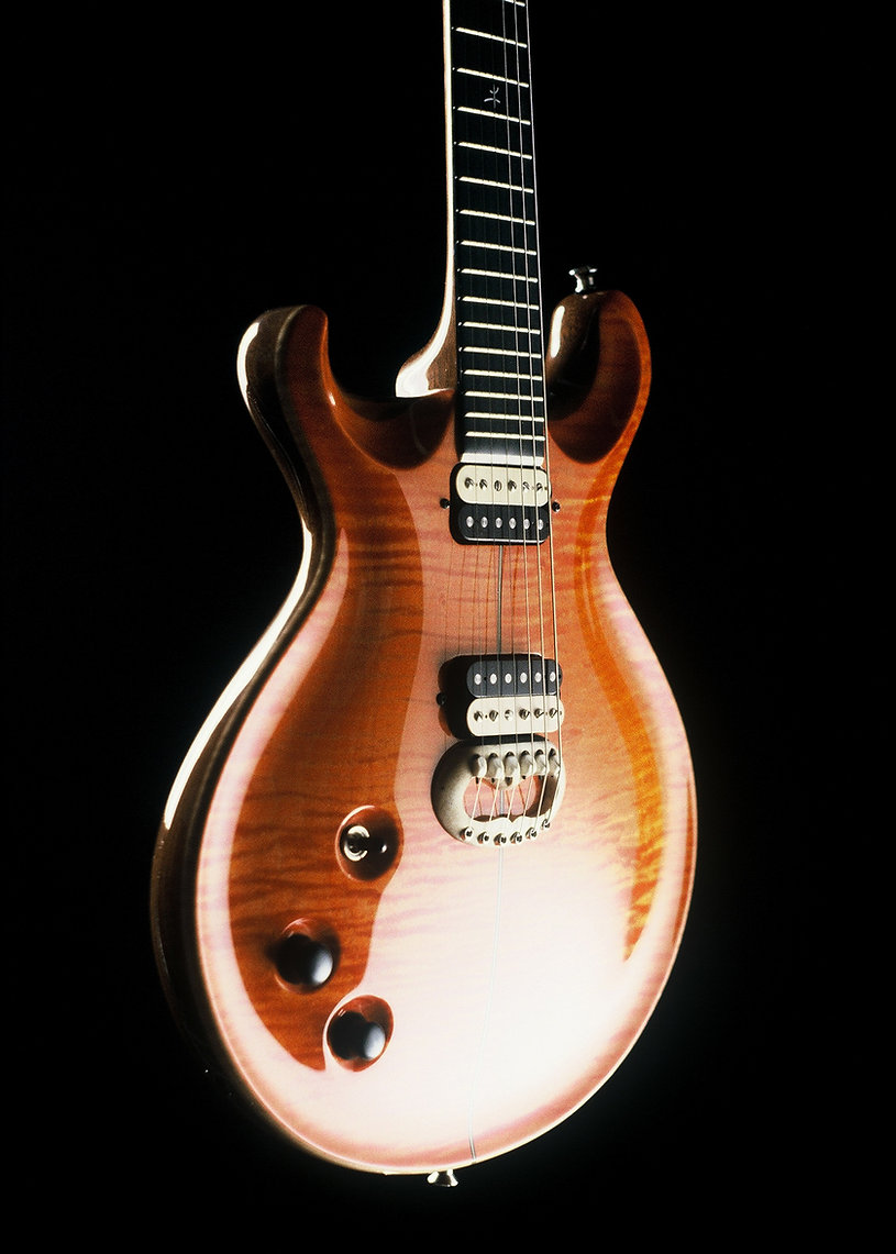 Thierry-Andre-Instruments-Projet-Orange-carved-top-electric