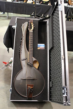 Multi 2 Thierry Andre Instruments - 20 string harp guitar with sympathetics and sub-bass