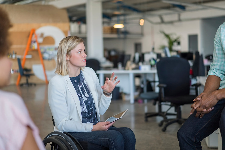 Disabled-businesswoman-discussing-with-c