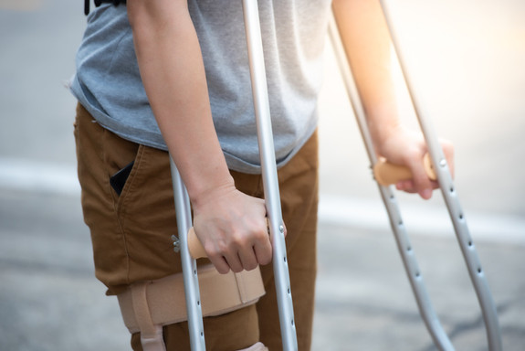 Disabled-woman-with-crutches-or-walking-
