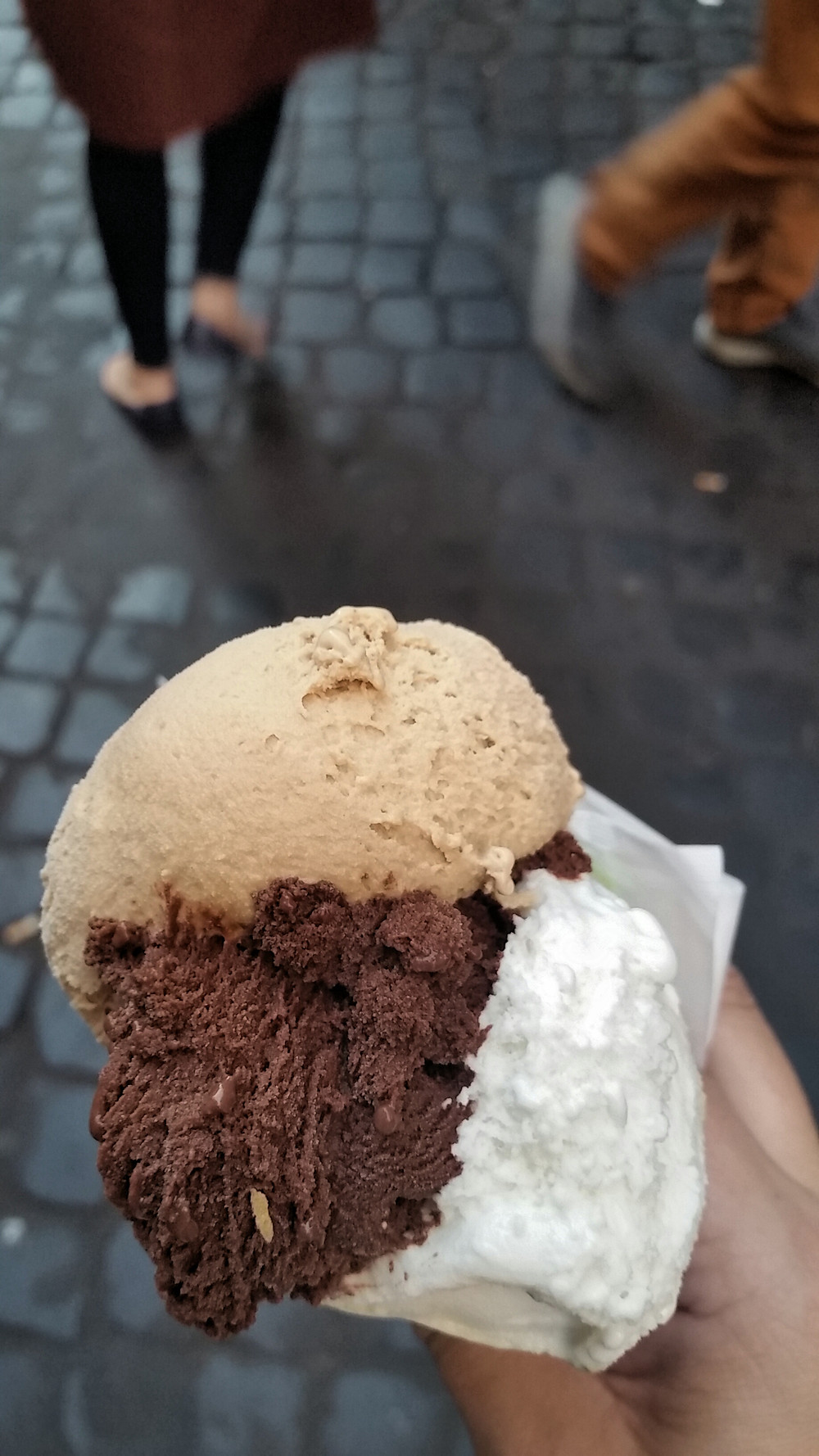 A cone of chocolate, sweet cream and hazlenut gelato.