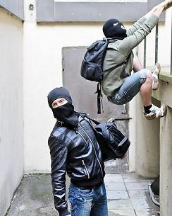 two-thieves-climbing-a-wall.jpg