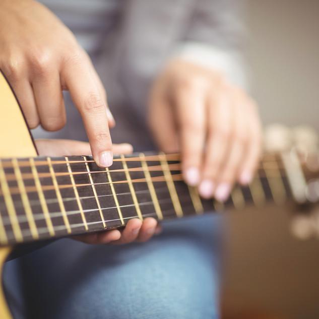Teacher Giving Guitar Lessons