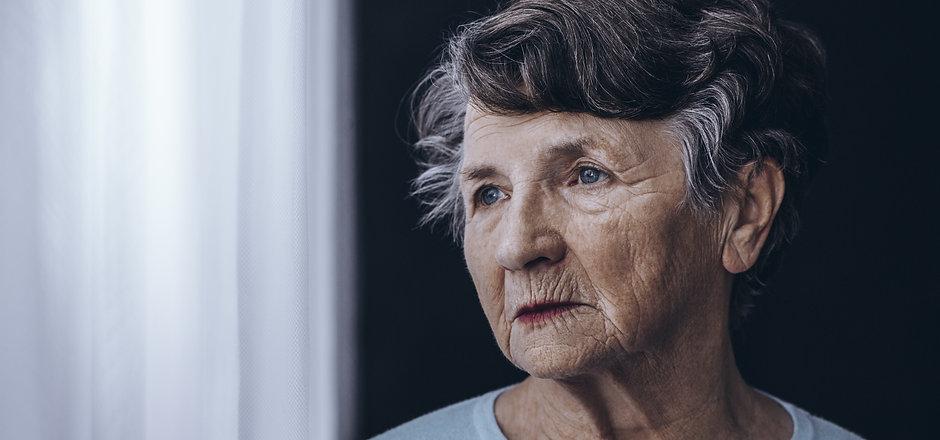 Elderly woman with memory problem spendi