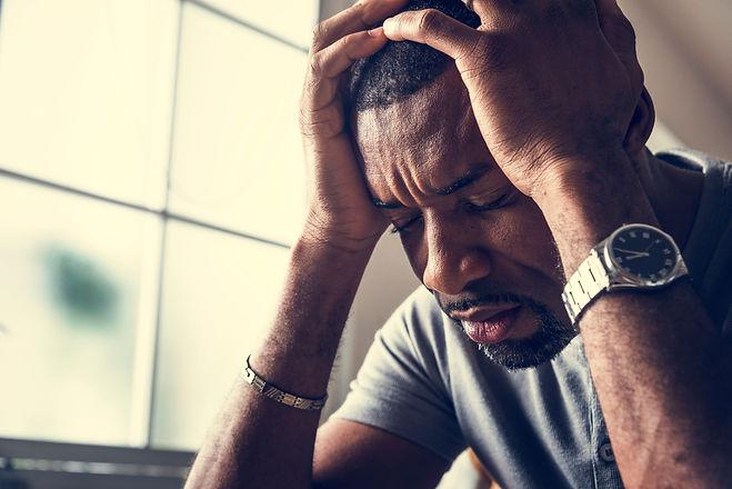 Black guy stressting and headache.jpg