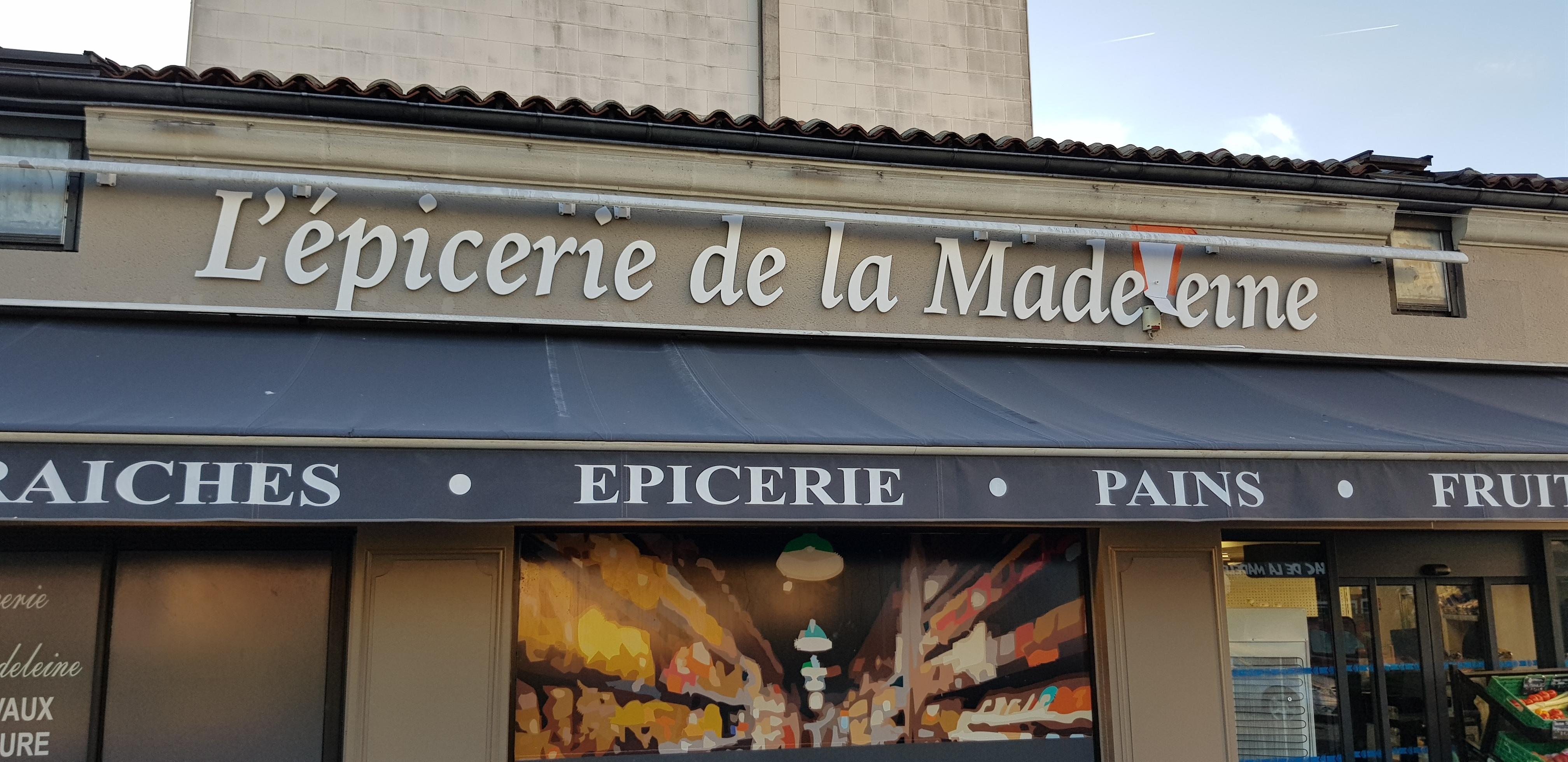 Enseigne et adhésif vitrine pour L'épicerie de la Madeleine
