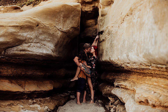 passionate_couple_kissing_wild_canyon.jpg