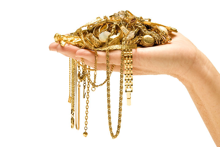 Hand Holding Expensive Gold Jewelry.jpg