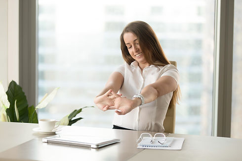 businesswoman-relaxing-muscles-after-finishing-job.jpg