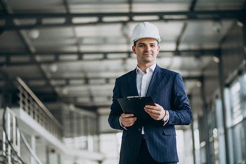 handsome-business-man-engineer-hard-hat-building.jpg