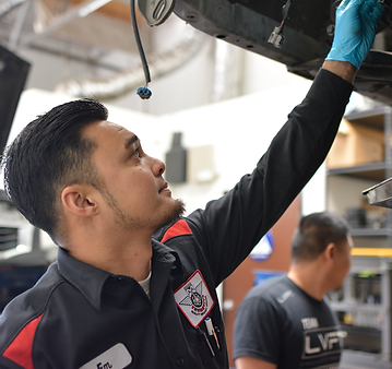 A mechanic fixing car