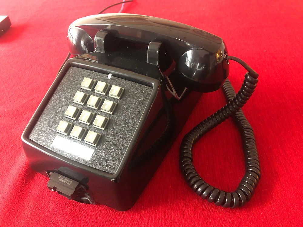 a picture of a corded desk phone, with a surprising experience coded inside