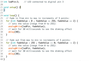 Code from fade example (above) used with two LEDs in parallel (left)