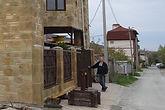 Отделка фасада декоративным бетоном под камень