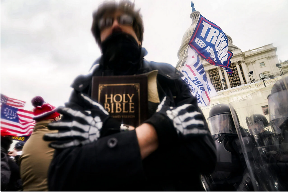 A Trump supporter carries a Bible outside the Capitol on Jan. 6, 2021, in Washington.