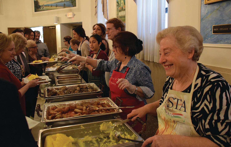 Serving polenta dnner at Casa Italiana