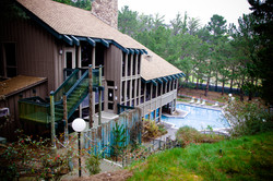 Side Of 3 Story Clubhouse & Pool